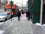 A frame signs on snowy sidewalk