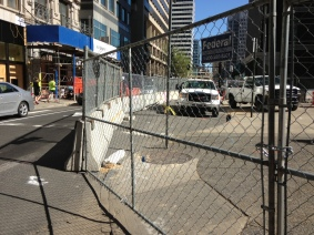 15th & Chestnut. NEC. 15th St sidewalk closed East side. Covered walkway on West side.