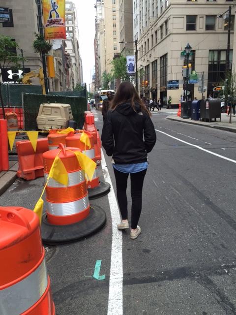 Person walkin in roadway in Center City Philadelphia