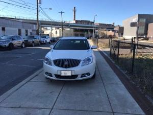 Car on Sidewalk 13 and W Palmer